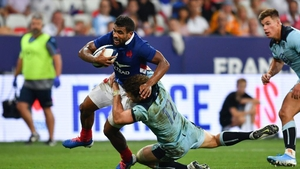 Wesley Fofana is tackled by Scotland's centre Duncan Taylor