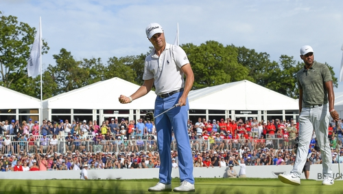 Justin Thomas celebrates victory on the 18th green