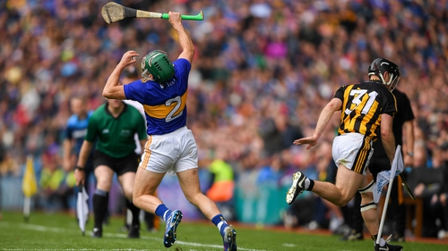 Cathal Barrett (l) reacts to Richie Hogan's challenge