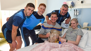 Ciara Sugrue with Tipperary players, from left, Barry Heffernan, Jerome Cahill, Séamus Callanan, Tipperary manager Liam Sheedy and the Liam MacCarthy Cup