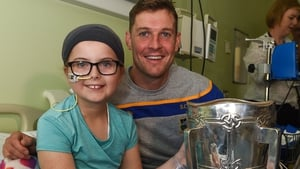 Carla O'Connor, aged 10 with Séamus Callanan of Tipperary and the Liam MacCarthy cup