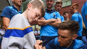 John O'Dwyer of Tipperary signs an autograph for  Harry Tutty
