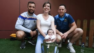 James Barry, left, and Seán O'Brien of Tipperary with Stacey Hughes and her daughter Leila Hughes-McDermott