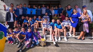 Tipperary players and management with Childrens Health Ireland staff and patients