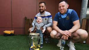 James Barry, left, and Seán O'Brien of Tipperary with Liam Tomney, aged 1