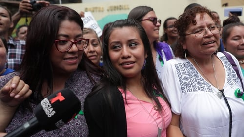 Evelyn Hernandez (centre) reacts after the court decision