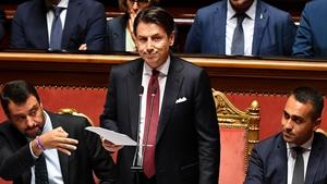 Giuseppe Conte (C) with ministers Matteo Salvini (L) and Luigi Di Maio during his resignation speech