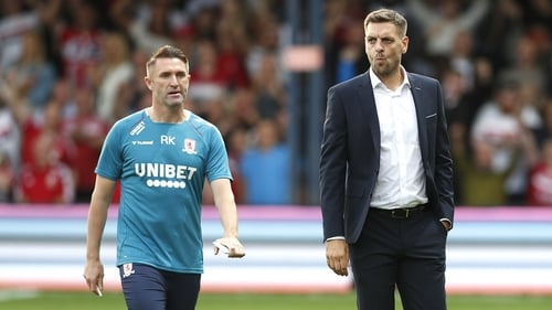Robbie Keane (L) pictured with Jonathan Woodgate