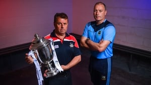 Cork manager Denis Ring (l) and and Tipperary boss Liam Cahill with the cup