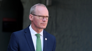 Simon Coveney accused the UK of reneging on commitments already made