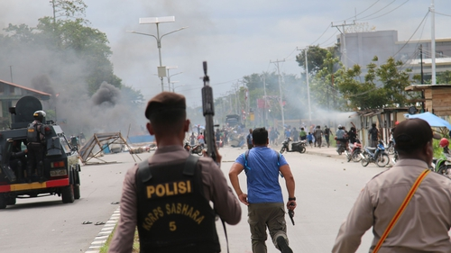 Indonesia's government has called for calm in Papua following riots