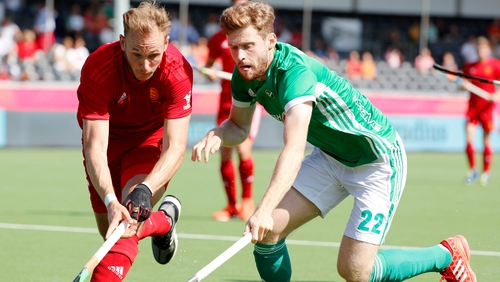 Ireland's goal scorer Michael Robson, right, in action against England