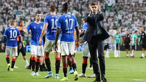 Steven Gerrard applauds the travelling support following the match in the Polish capital