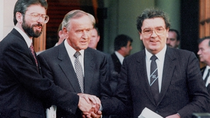 Albert Reynolds is flanked by Gerry Adams (L) and John Hume
