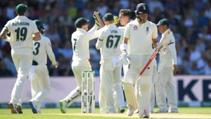 England's Rory Burns walks off after being caught out for nine runs off the bowling of Pat Cummins
