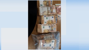 The cash was in two packages concealed underneath a vehicle