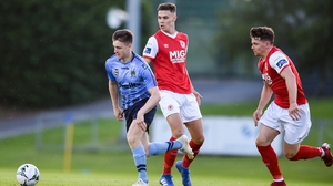 Jason McClelland of UCD in action against Cian Coleman, centre, and Dean Clarke of St Patrick's Athletic