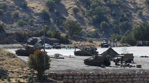 Israeli soldiers with their artillery unit deployed at the Israeli-Syrian border, in the Golan Heights