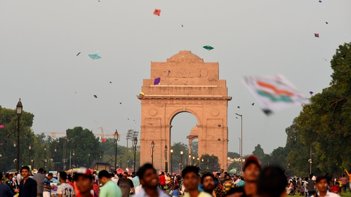 People fly kites on the occasion of 73rd Independence Day, near India Gate, on 15 August in New Delhi