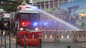 Police warned protesters they would deploy the water cannon jets if they did not leave the area