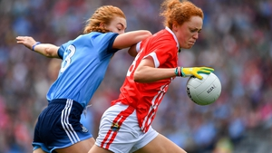Niamh Cotter of Cork in action against Lauren Magee
