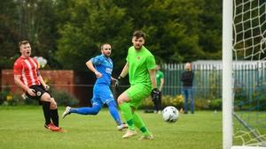 Alan McGreal scores the third Crumlin goal