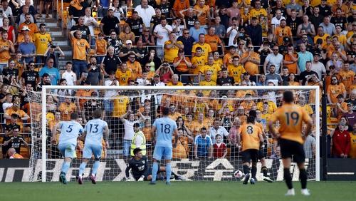 Raul Jimenez scores from the penalty spot