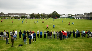 Fans watch on at Pearse Park during Crumlin United's 3-1 victory over Lucan United