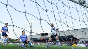 Michael Duffy slots home Dundalk's second goal in their win over UCD