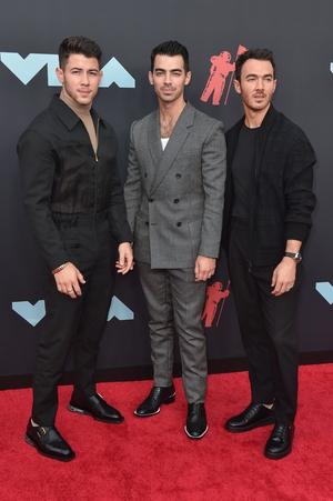 Kevin Jonas (R) in David Yurman, Joe Jonas (C) in David Yurman, and Nick Jonas (L). Photo: Getty.