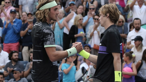 Andrey Rublev of Russia (r) and Stefanos Tsitsipas of Greece