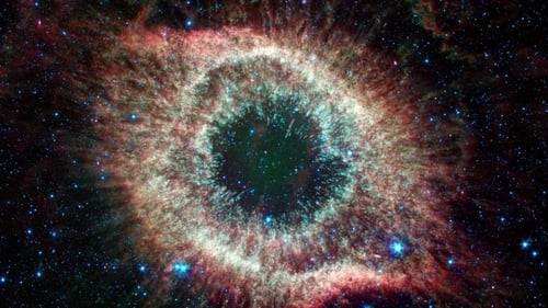 Located about 700 light-years from Earth, the eye-like Helix nebula is a planetary nebula, or the remains of a Sun-like star   Image: NASA/JPL-Caltech
