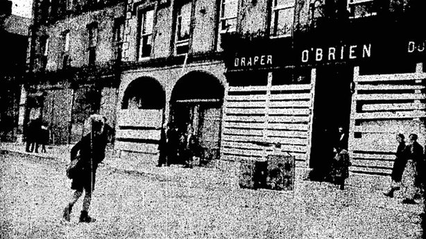 A picture of Queen's Square in Fermoy showing shopfronts boarded up after the recent scenes in the town Photo: Cork Examiner, 10 September 1919