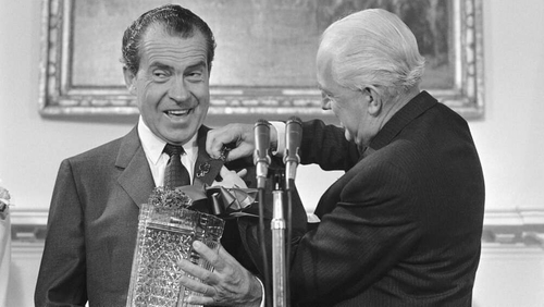 Irish Ambassador to the United States William Fay pins shamrocks on Richard Nixon's lapel on St Patrick's Day 1969 during an event at the White House in Washington. Photo: AP/US Embassy Dublin