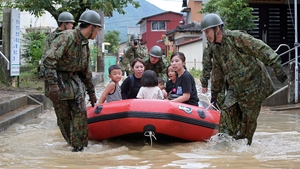 People are rescued by defence force members in Takeo, Saga prefecture