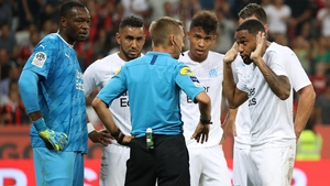 Marseille defender Jordan Amavi (R) argues with the referee over the awarding of a penalty kick during the derby clash with Nice