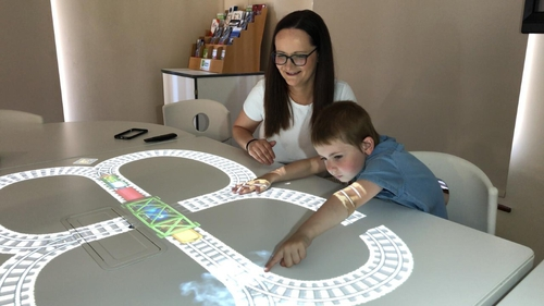 Claire Daly and her son Jack using the 'magic table' at Trim Library