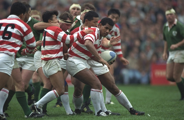 9 Oct 1991: Sinali Latu of Japan holds onto the ball as the Irish pack surge forward in the Ireland v Japan match during the 1991 Rugby Union World Cup at Lansdowne Road in Dublin, Ireland. Ireland won the match 32-16. \ Mandatory Credit: Shaun Botterill/Allsport