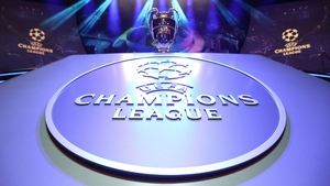 The Champions League trophy stands on display during the UEFA Champions League football group stage draw ceremony