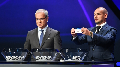Wesley Sneijder performs the draw in Monaco
