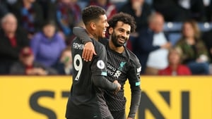 Roberto Firmino celebrates a goal with Mohamed Salah
