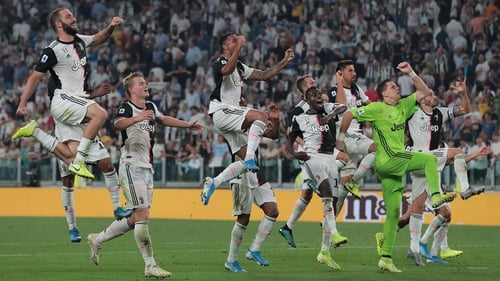 Juventus players celebrate after the final whistle