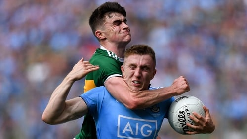 Sean O'Shea fouls Paddy Small to give Dublin one last chance to win the game. They did not take it