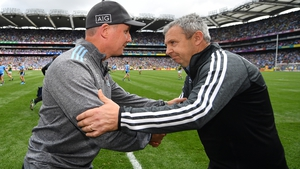 Jim Gavin and Peter Keane shake hands after the drawn final