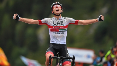 Tadej Pogacar celebrates victory in the mountains on stage 9