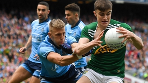 Seán O'Shea of Kerry is tackled by Jonny Cooper