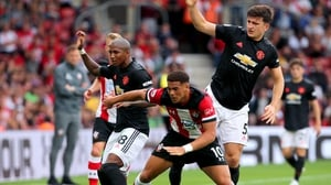 Southampton's Che Adams (centre) clashes with Manchester United's Ashley Young (left) and Harry Maguire