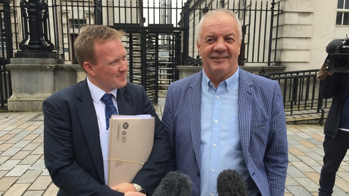 Raymond McCord (right) pictured outside Belfast High Court