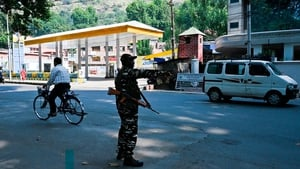 An Indian paramilitary soldier stands guard on a street during a lockdown in Srinagar