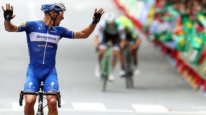 Philippe Gilbert looks back at his nearest pursuers as he crosses the line in Bilbao